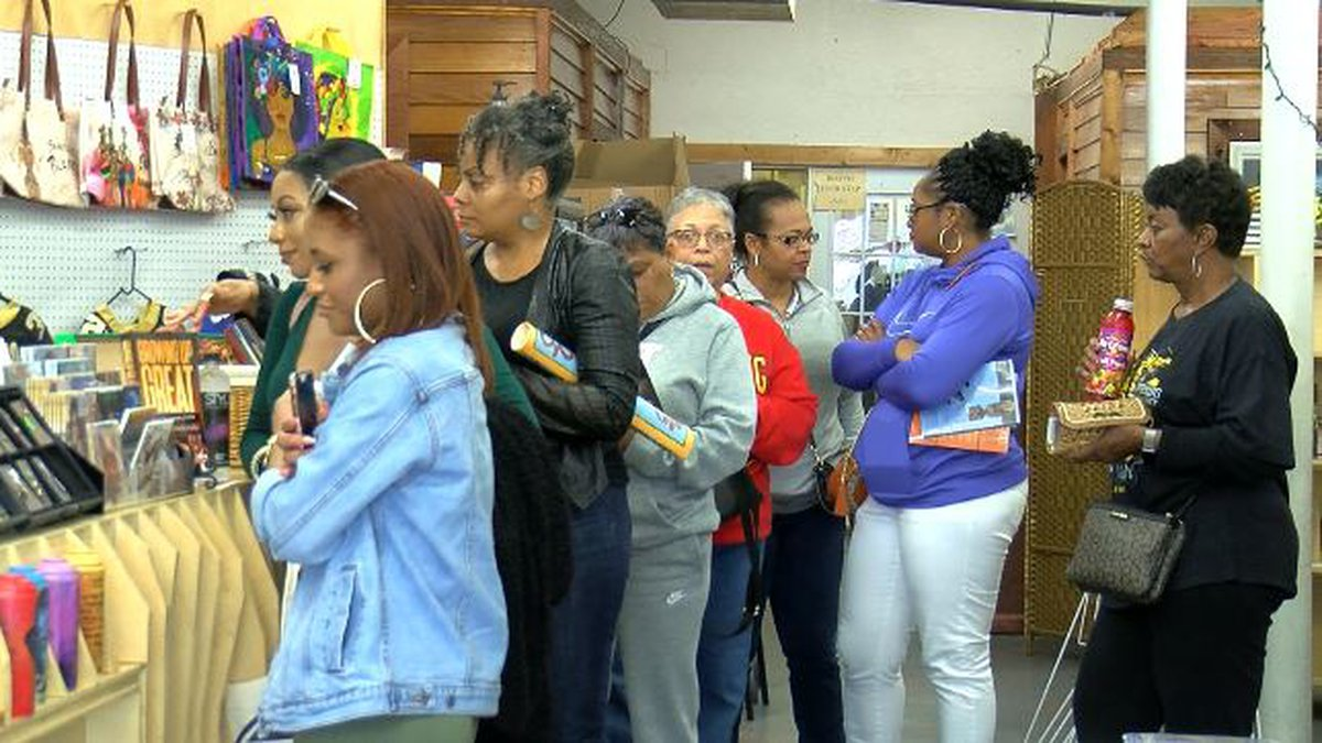 Customers line up at Community Book Center