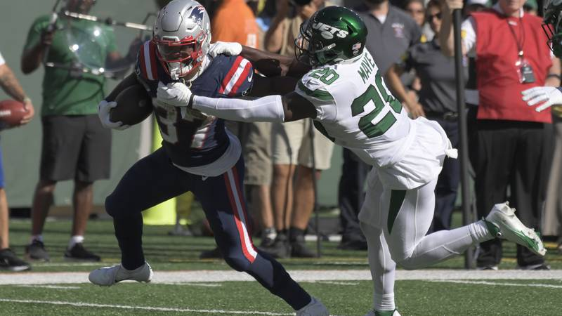 New York Jets' Marcus Maye, right, tries to tackle New England Patriots' Damien Harris during...