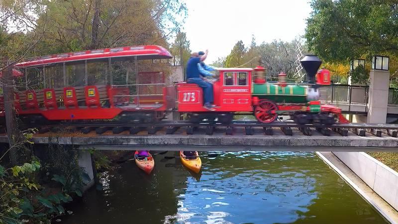 The New Orleans City Park train travels across a bridge near the Museum of Art
