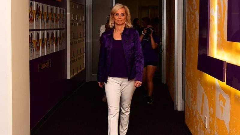 New LSU women's basketball head coach Kim Mulkey walks through the facility after arriving on...