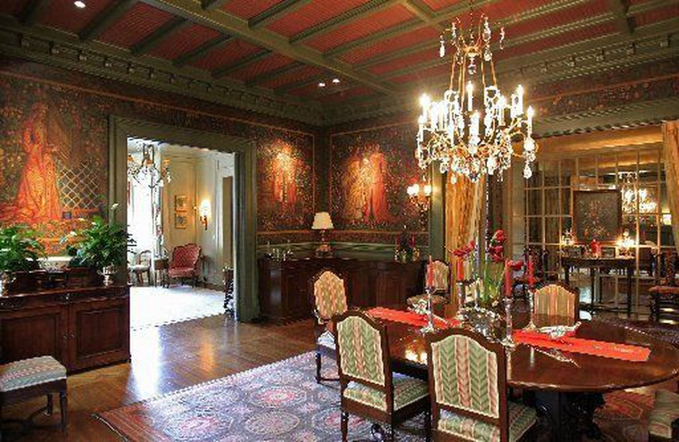 The dining room is an atmospheric space with walls covered in murals -- actually tempera on...