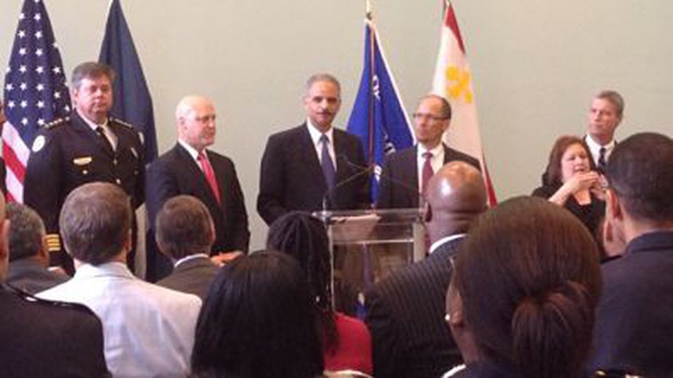 U.S. Attorney General Eric Holder with city officials (Jessica Holly)