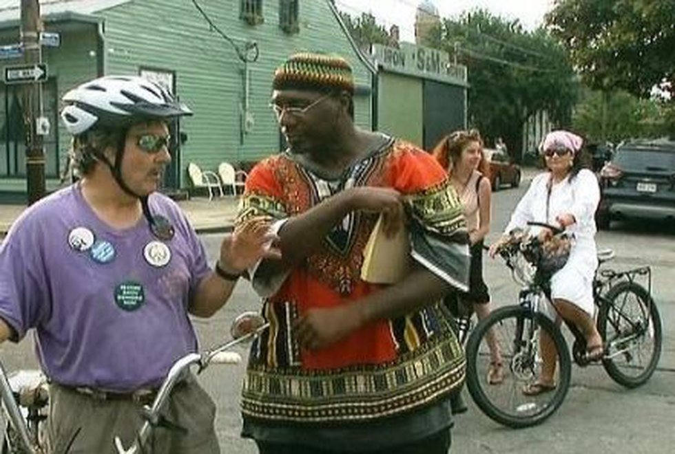 Neighbors and activists talk on Mandeville St. in Marigny