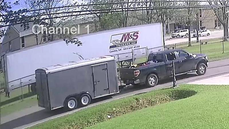 Four men in a pickup truck pulled up and hitched up to a trailer carrying $30,000 worth of band...
