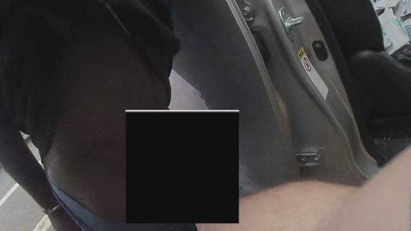 A still picture from body camera video from BRPD shows a strip search in broad daylight.