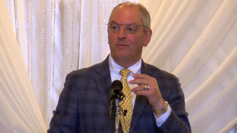 Gov. John Bel Edwards addresses hundreds after the CDC relaxed mask guidance for vaccinated...