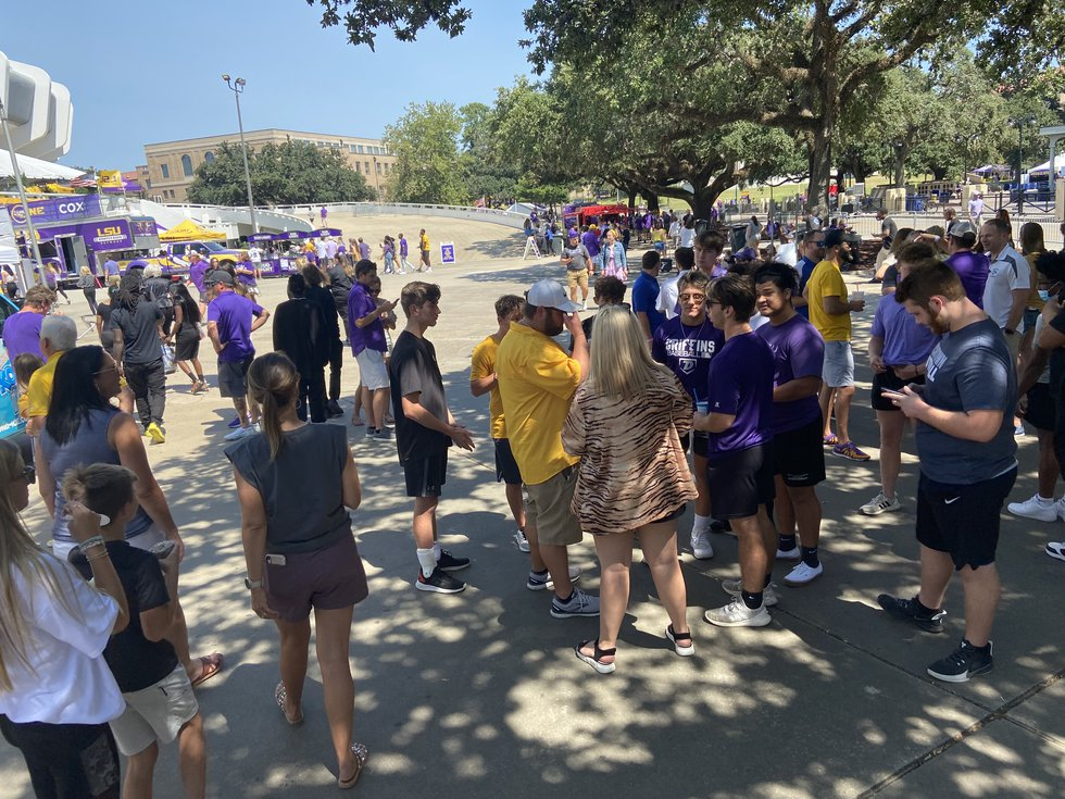 Fans tailgate between the Pete Maravich Assembly Center and Tiger Stadium on LSU's campus in...