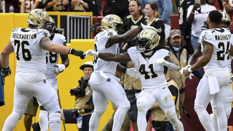 New Orleans Saints running back Alvin Kamara (41) celebrates second half touchdown with...