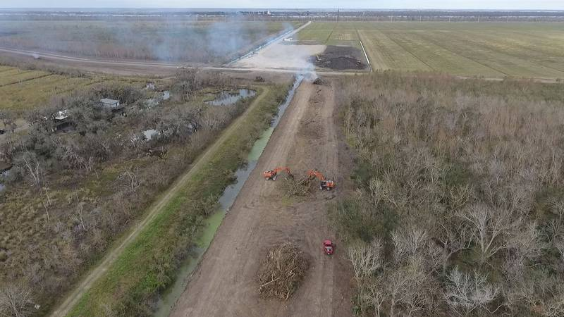 Contractors for the U.S. Army  Corps of Engineers clear land for the New Orleans to Venice...