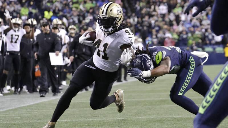 New Orleans Saints' Alvin Kamara runs for a touchdown after a pass reception as Seattle...