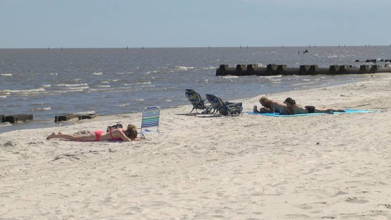 Beachgoers enjoy time on the recently re-opened Harrison County beaches