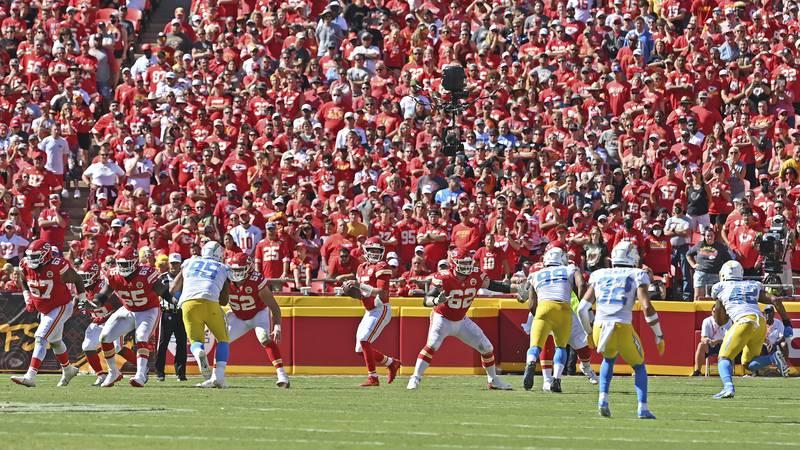 Kansas City Chiefs quarterback Patrick Mahomes (15) drops back during an NFL football game...