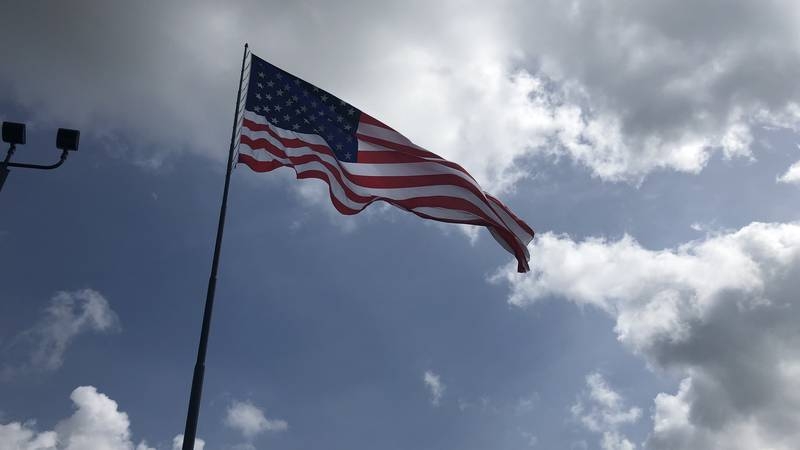 The flag flies from a 150-foot tall pole.