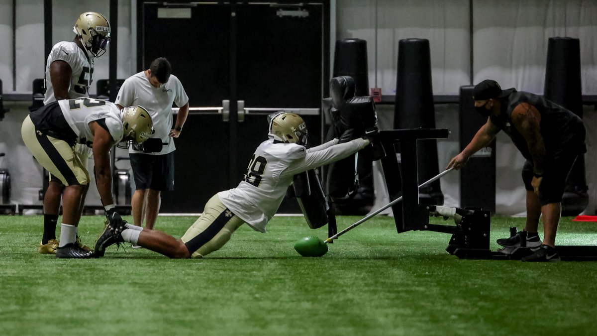 New Orleans Saints defensive end Payton Turner (98) works on a sled drill during NFL football...
