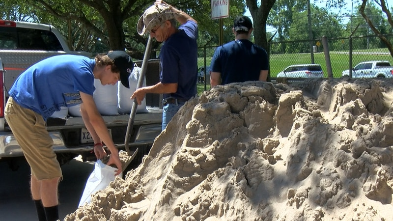 Residents fill sandbags because of storm threat.