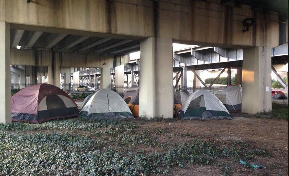 Homeless camp under the expressway, via Carolyn Scofield