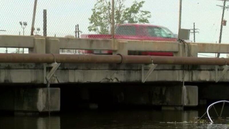 Truck drivers on an old bridge.