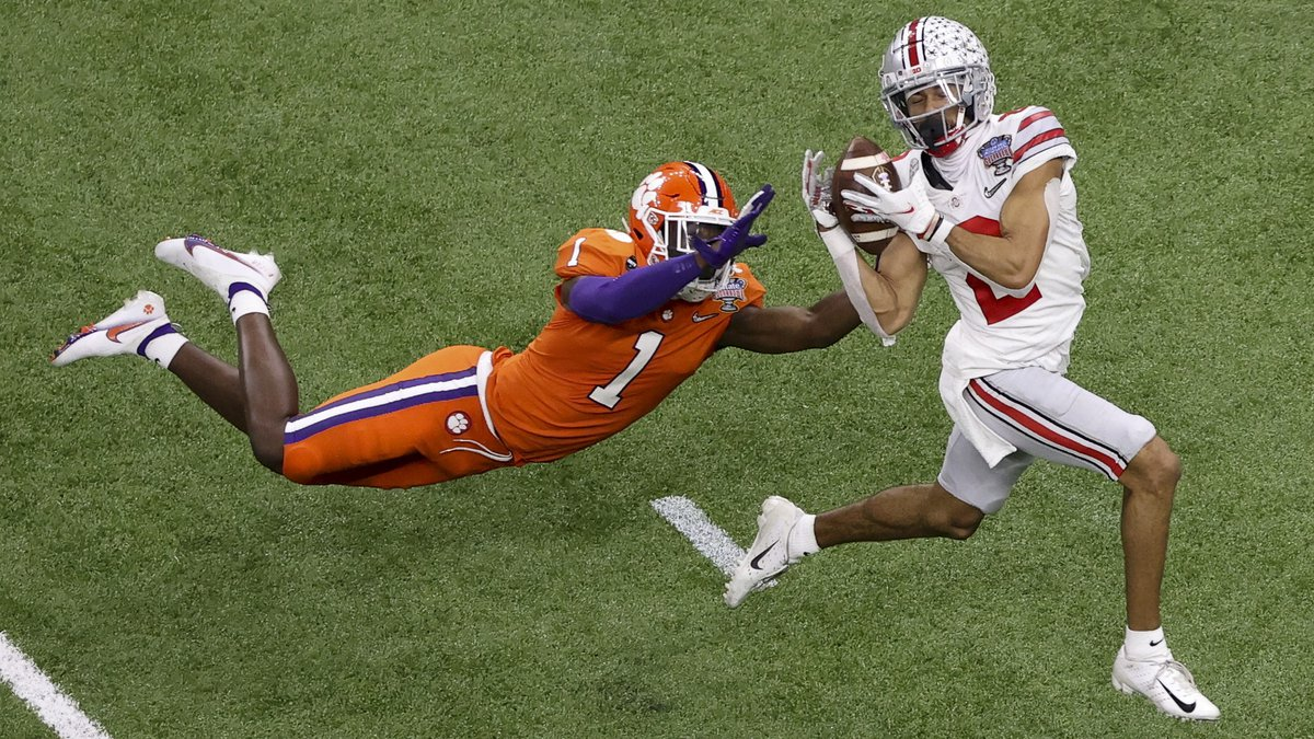 FILE - Ohio State wide receiver Chris Olave catches a touchdown pass in front of Clemson...