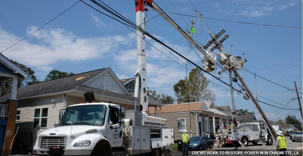 Entergy crews fix power lines in Chalmette, La. following Hurricane Ida.