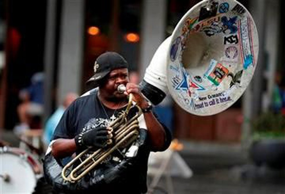 Street musicians perform for festival go-ers in Jackson Square on the first day of the annual...