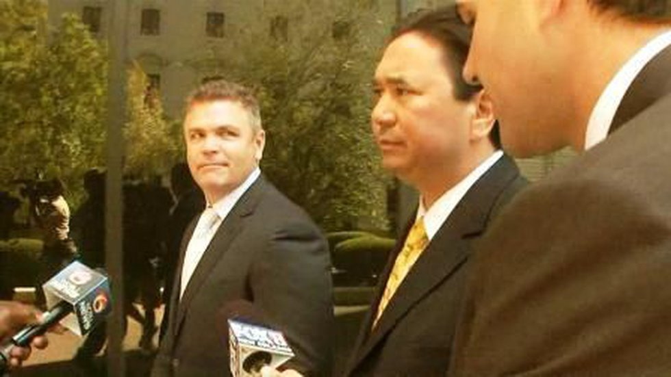In this file photo, Aaron Bennett (left) walks with attorney David Courcelle outside federal...