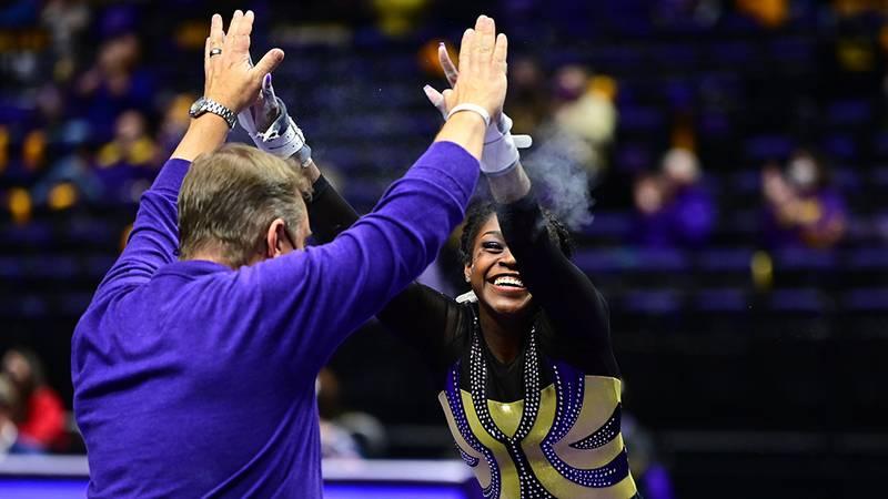 Kiya Johnson celebrates with head coach Jay Clark.