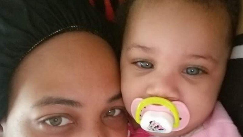 Erica Hall, pictured with her 1 year old daughter, was stabbed multiple times and shot in the...