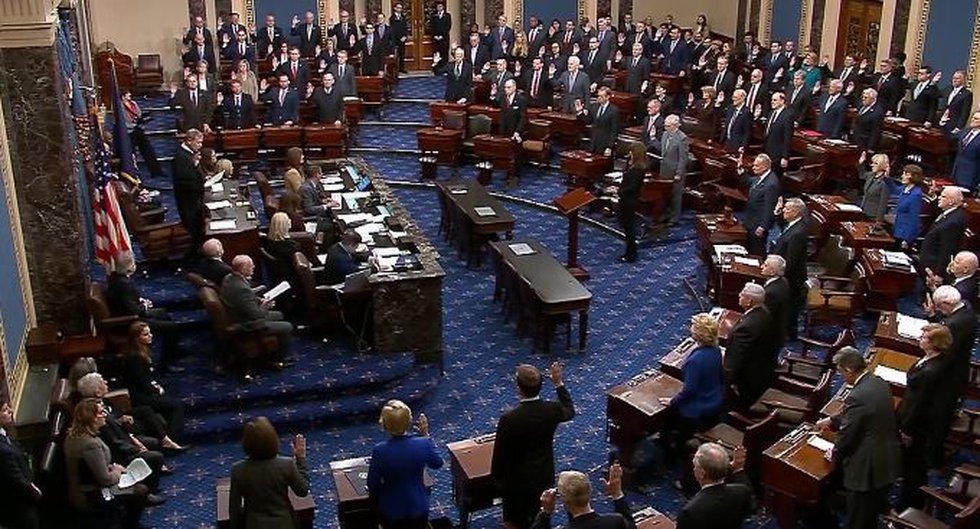 U.S. Supreme Court Justice John Roberts swears in members of the Senate to serve as jurors for...