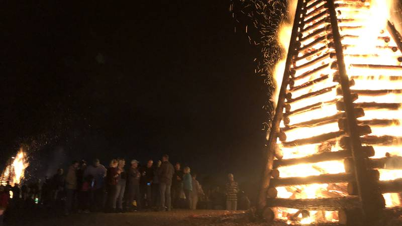 It's a tradition in the river parishes to light bonfires on the levee to help guide Papa Noel...