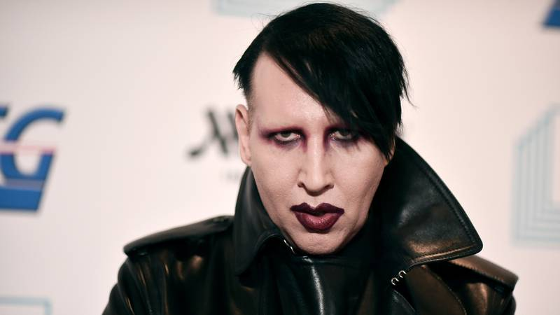 """FILE - In this Dec. 10, 2019, file photo, Marilyn Manson attends the 9th annual """"Home for the..."""